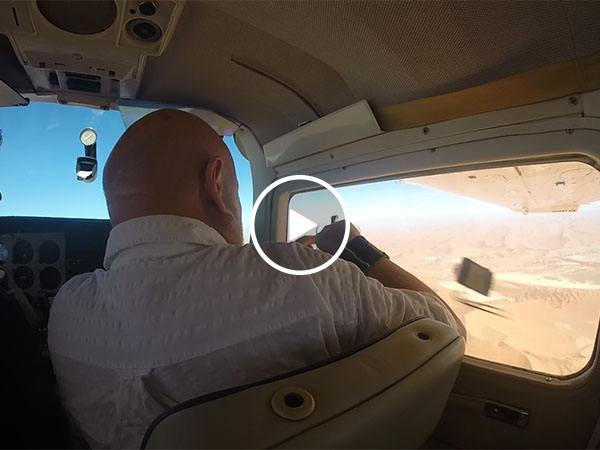 Guy gets his camera sucked out of airplane window (Video)