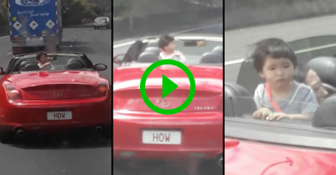 Kid walks around back of moving convertible (Video)