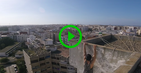 Man does workout on top of high-rise building (Video)
