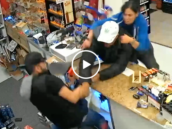 Family fights off flair gun wielding robber (Video)