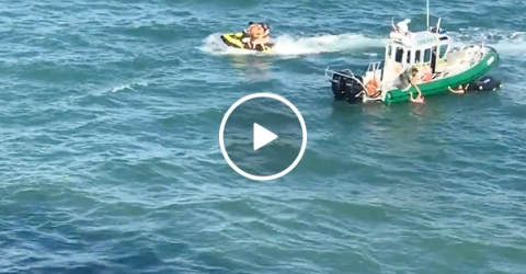 Cruise ship nearly runs over jet skiers (Video)