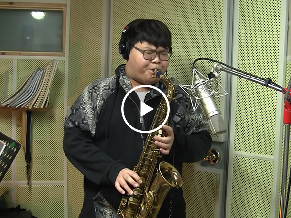 Kid nails Livin' on a Prayer sax cover