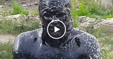 Russian idiot jumps in oil pool with predictable results (Video)