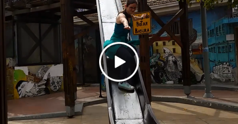 Woman in glasses attempts slide standing up, in hilarious fail (Video)