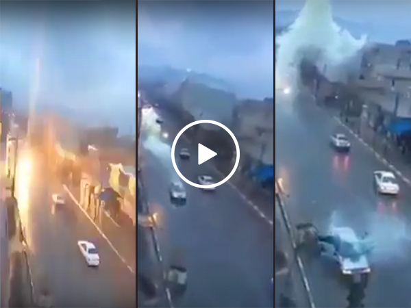 Lightning strikes a car as it drives down the road (Video)