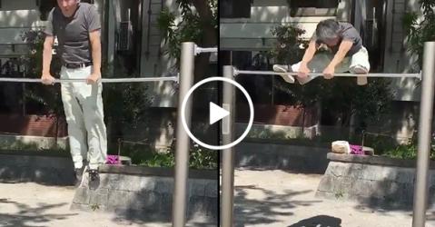 Old Asian man flips on gymnastics bar like a champ (Video)