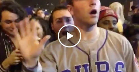 Cubs fan stops a fight the only way he knows how (Video)