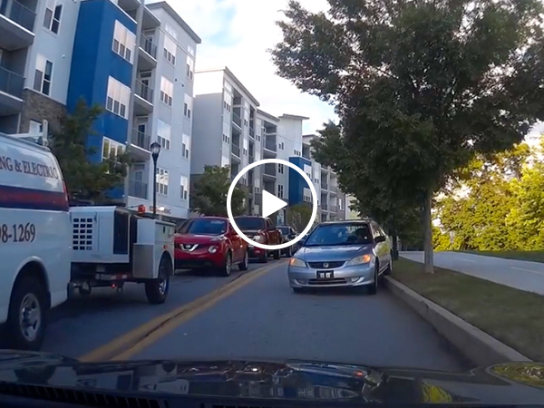 Idiot driver endures the longest 'reverse of shame' ever (Video)