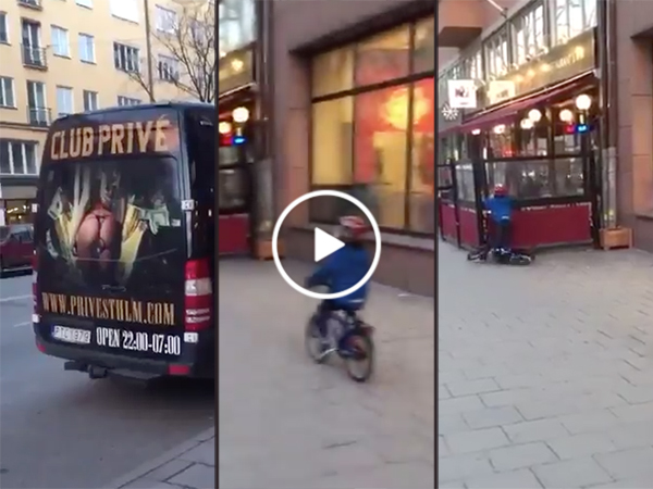 Kid crashes bike while looking at strip club advertisement