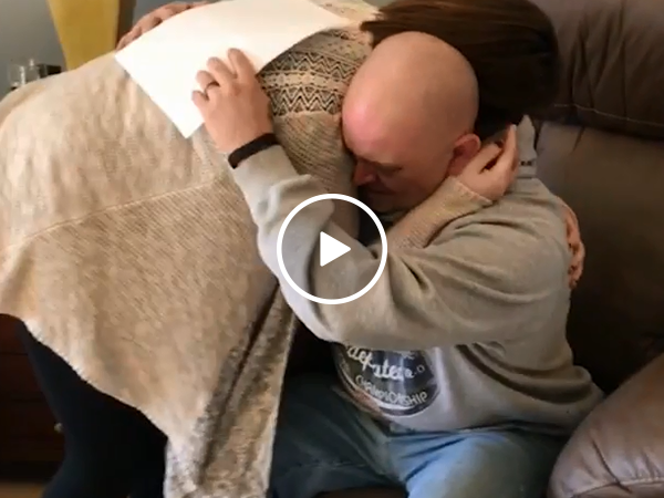 Touching moment stepdad is surprised with adoption papers (Video)