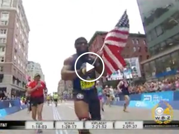 Amputee runs Boston Marathon with flag in hand
