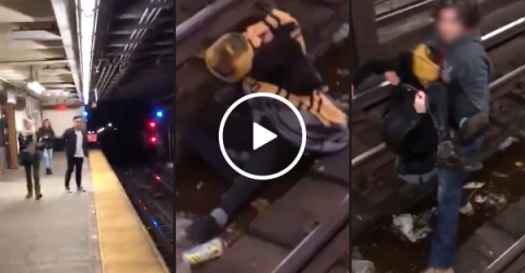 Man saves guy after falling onto subway tracks (Video)