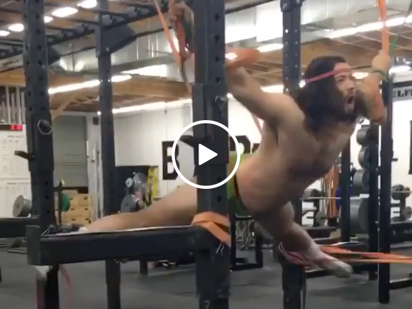 Guy strapped to elastic bands has a crazy new workout (Video)