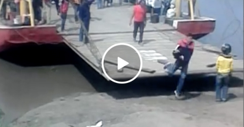 Impatient man nearly gets crushed to death by ferry (Video)
