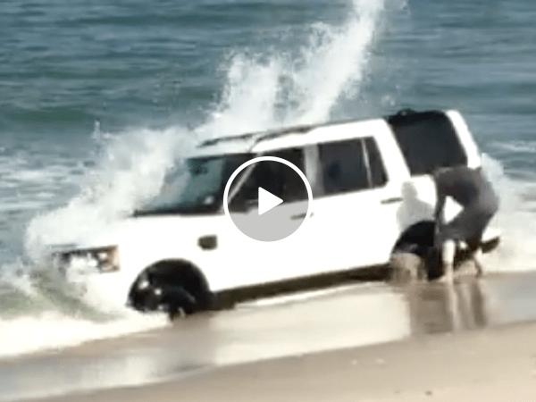 Kid gets Land Rover stuck in beach (Video)