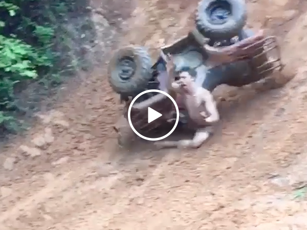 Guy gets rag dolled by ATV (Video)