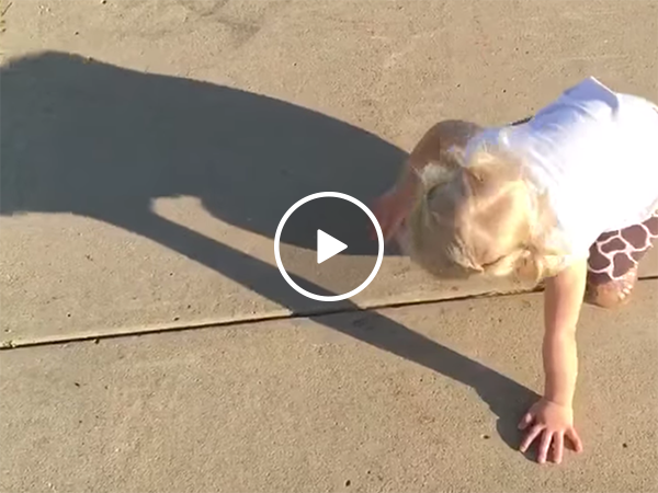 Little girl really wants to get rid of her shadow (Video)