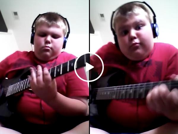 Little boy plays badass original riff on his guitar (Video)