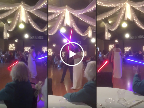 Couple has lightsaber fight for first dance