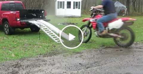 Guy fails at loading motorcycle into his truck