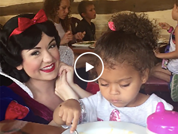 Little girl ignores Snow White