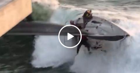 Terrifying moment sailboat capsizes into pier (Video)