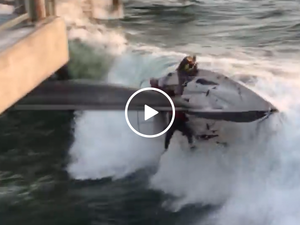 Terrifying moment sailboat capsizes into pier (Video)
