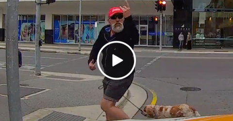Angry pedestrian gets instant karma (Video)