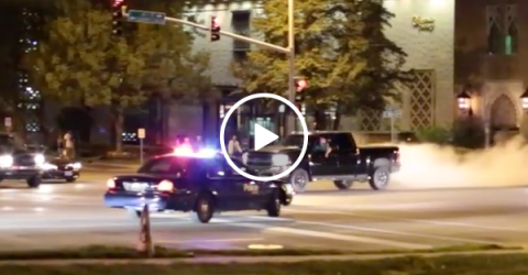 Truck does sick burn out in front of cop (Video)
