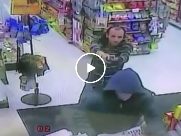 Armed robber finds out he's not the only one with a gun (Video)