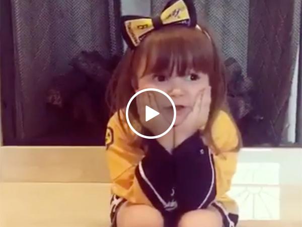 Young girl gives team inspirational speech