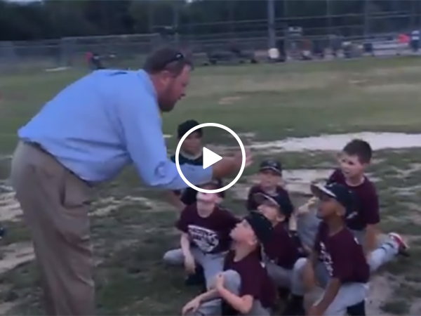 Little league coach gives pep talk