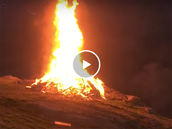 Bonfire explodes without warning (Video)