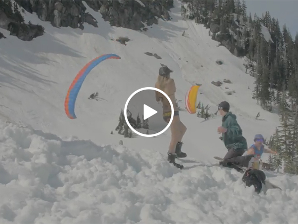 Parachuter almost hits skier