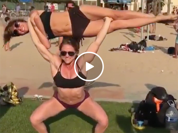 Ripped girl squats her friend (Video)