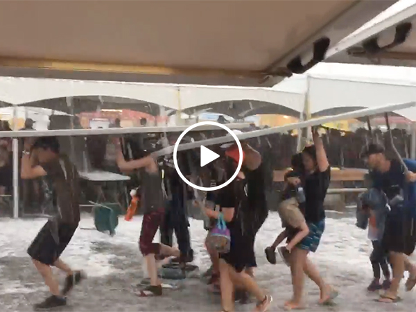 Hail storm causes people to run
