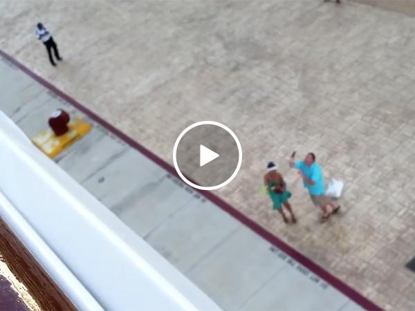 Man tries to throw phone onto ship