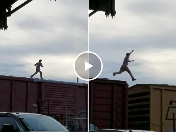 Guy runs on top of train