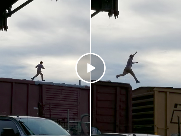 Guy runs on top of train