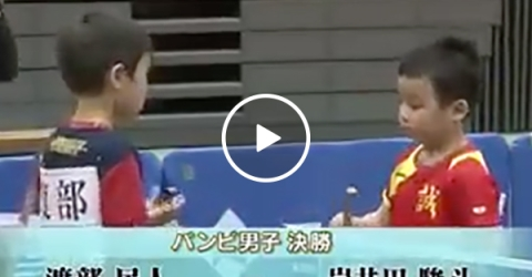 Young kids play intense ping pong game