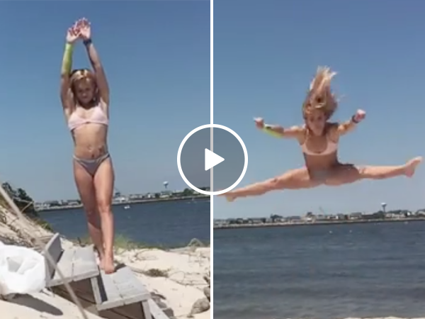 Beautiful woman does impressive flips at the beach (Video)