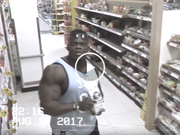 Bodybuilder flexes on camera in store