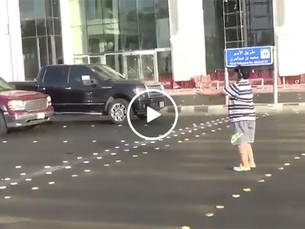 Kid dances in middle of street