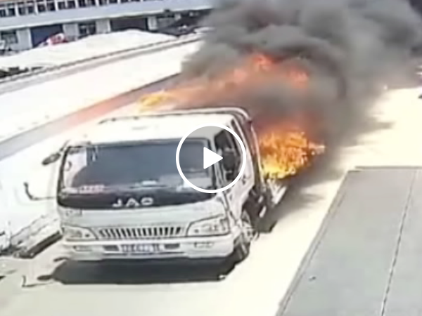 Brave Chinese worker risks life to drive flaming truck away from building (Video)