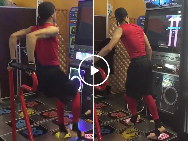 A guy gets really into dancing video game