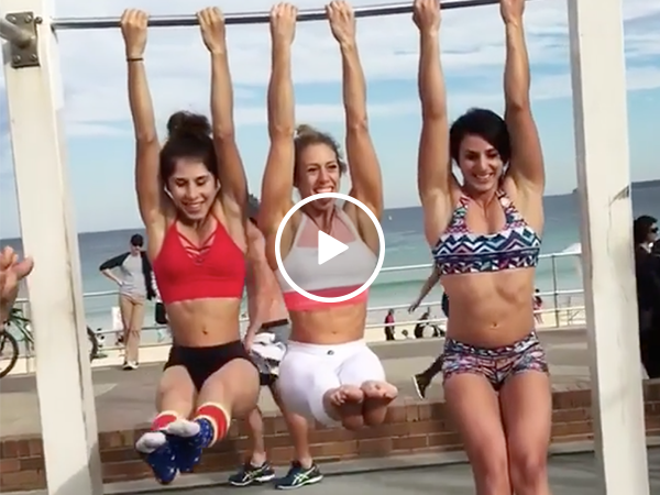 Beach babes show off their pull up skills (Video)