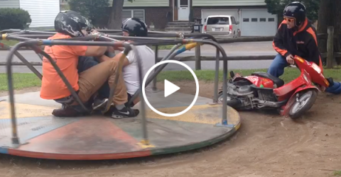 Three idiots spin on merry go round using scooter FAIL (Video)