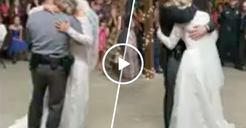 Officers share dance with bride who lost her father in the line of duty (Video)