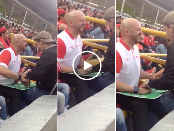Father helps blind son watch soccer game with mini-pitch