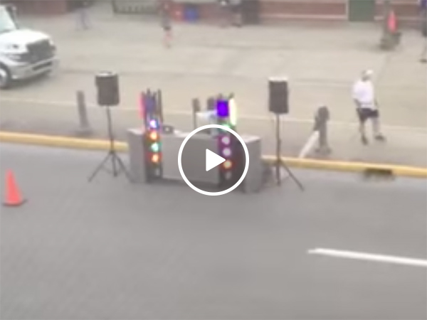 Hungover woman wakes up to an MC and music across the street